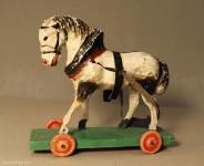 Herst.unbekannt: Pferd aus Holz mit Rädern