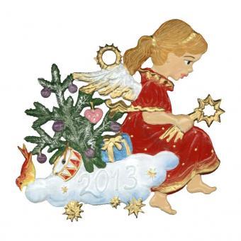 Ein Engel schaut dem weihnachtlichen Treiben von einer Wolke aus zu...