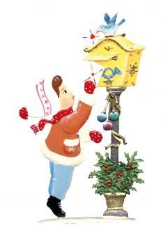 Ein Kind steckt den Wunschzettel in den Weihnachtsbriefkasten
