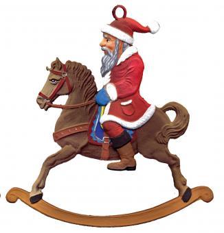 Weihnachtsmann auf Schaukelpferd