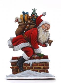Weihnachtsmann steigt durch den Kamin hinab