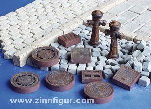 Kanaldeckel und Hydranten