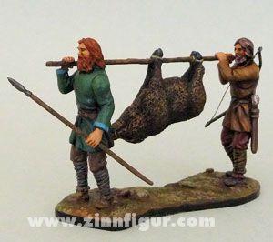 Zwei Jäger mit Wildschwein