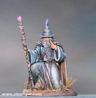 Kniender Magier mit Stab